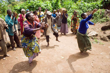 KISORO, UGANDA - DECEMBER 31, 2013  Unidentified pygmy people sing and dance in their village