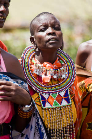 tribal park: Portrait of a singing woman from the Maasai tribe