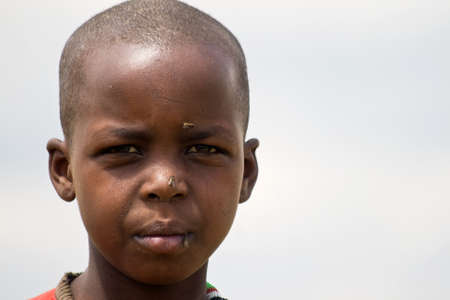 Portrait of a Masai girl in Masai Mara National Park, Kenya Stock Photo