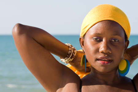 ugandan: Portrait of an African woman in front of the sea  Stock Photo