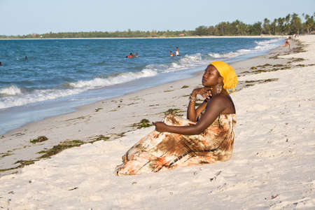 interested: African woman looking interested to the sea  Stock Photo