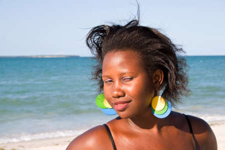 ugandan: Beautiful African woman enjoying the beach