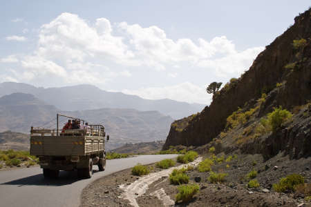 ethiopian: ETHIOPIAN HIGHLANDS, ETHIOPIA - FEBRUARY 20, 2010: Unidentified Ethiopian workers stand on a truck in the Ethiopian Highlands.