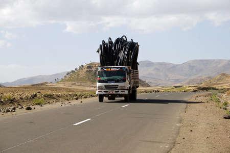 highlands: ETHIOPIAN HIGHLANDS, ETHIOPIA - FEBRUARY 20, 2010: Truck drives with goods on Ethiopian Highlands.