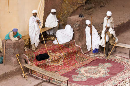 LALIBELA, ETHIOPIA - FEBRUARY 23, 2010: Unidentified priests pray in one of eleven monolithic rock-cut churches in Lalibela