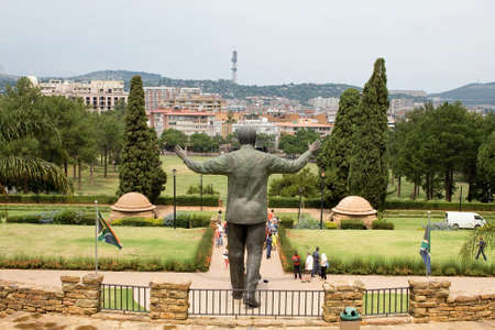 PRETORIA, SOUTH AFRICA - MARCH 22, 2015: Unidentified people take images of the nine metre tall bronze statue of former president Nelson Mandela of South Africa at the Union buildings in Pretoria. Nelson Mandela was the South Africa
