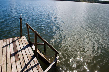 Wooden platform lead into lake.