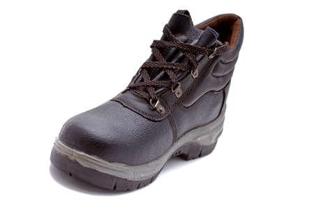 veiligheid bouw: werken schoen over witte achtergrond Stockfoto