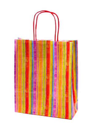 shopping paper bag with colorful lines, isolated on white background photo