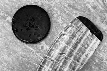 hockey stick and puck on ice rink photo
