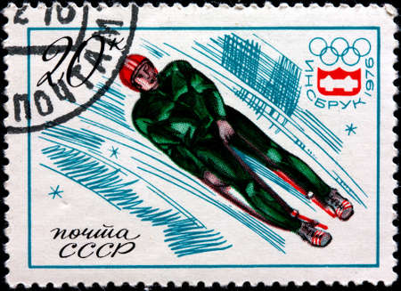 bobsled: Innsbruck Switzerland Olympic games - CIRCA 1976  A stamp printed in Russia shows a bobsled skating, circa 1976