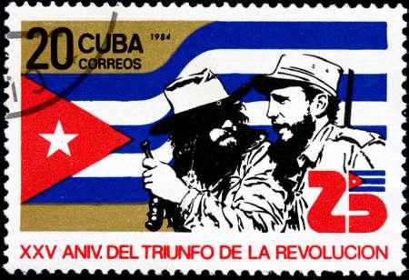 bandera cuba: CUBA - alrededor de 1984 Un sello postal muestra del 25 Aniversario del Triunfo de la Revoluci�n Cubana, circa 1984 Editorial