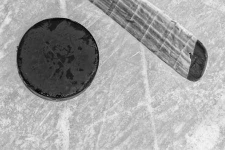Hockey Stick and Puck on White Ice photo