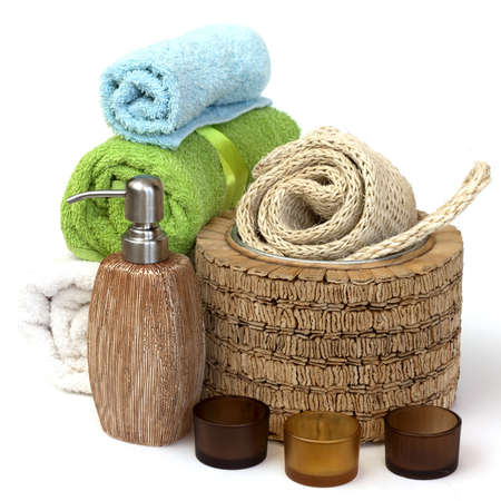 Ceramics Shampoo bottle with towels. Isolated on white background  photo