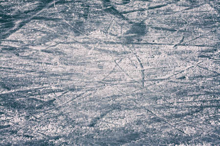 ice arena: Surface of an Outdoor Ice Rink Replete with Skate Marks.
