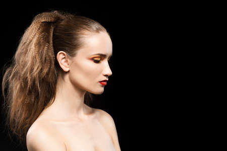 Portrait of the topless beautiful girl on a black background with a vanguard make-up. Pure healthy leather. Vanguard hairstyle. Copy space. Stock Photo