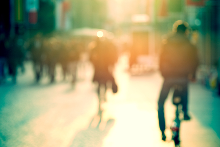 cyclist in the street, abstract blurry picture Reklamní fotografie