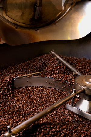 hopper: Roasting process of coffee, screening and cooling in the hopper Stock Photo