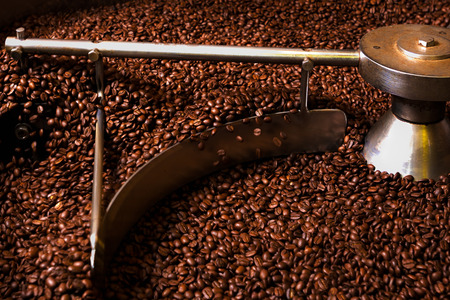 roaster: Roasting process of coffee, screening and cooling in the hopper Stock Photo