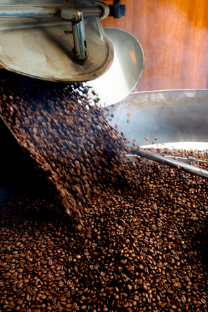roasting process of coffee, beans falling in the hopper