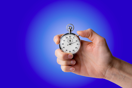 timer hold in hand, pressed button - blue background