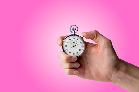 timer hold in hand, pressed button - pink background