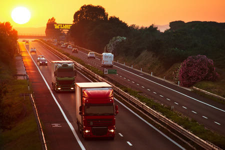 cars in the highway at sunset