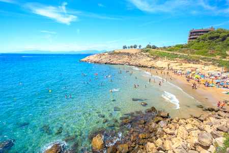 Spain, Salou. Beautiful sea lagoon with beach and tourists. Sunny day in Spain.