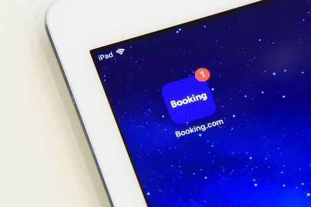 New york, USA - February 02, 2018: Booking application icon on iPad screen with new reminder.
