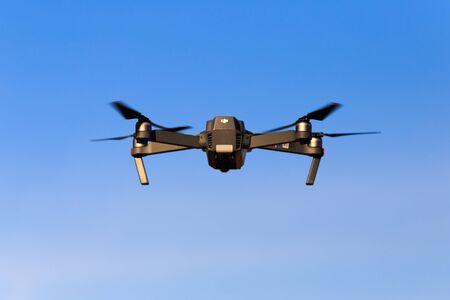 New York, USA - March 24, 2018: DJI Mavic pro drone on blue sky background.
