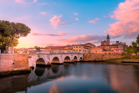 Famous bridge in Rimini, Italy. Rimini landmarks. Beautiful Rimini cityscape in the evening. Stock Photo - 104580868