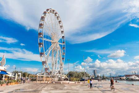 Rimini, Italy - June 14, 2018: Attractions. Rimini Ferris wheel on pier. Editorial
