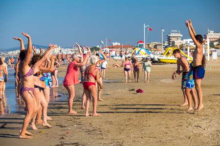 Rimini, Italy - June 20, 2018: Animation for aged people on seashore in Rimini.