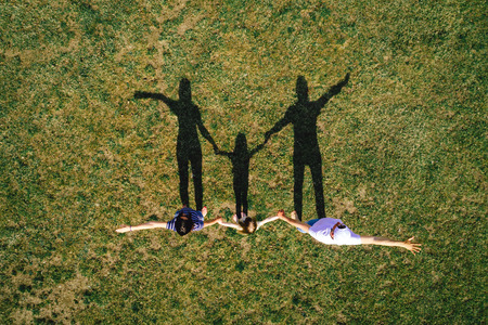 Family portrait outdoors top view. Family happiness concept. Freedom background. Imagens