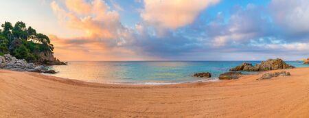 Spain, Catalonia, Costa Brava, Lloret de mar resort. Clean beach in the morning. Tropical landscape with beautiful sky. Cala Boadella beach.