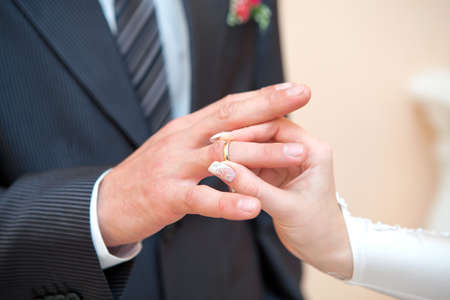 wedding ring hands: Newly-married couple on wedding dresses gold rings