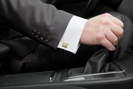 gear handle: Hand of the driver of the car  Stock Photo