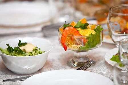 Salad with shrimps on a table photo