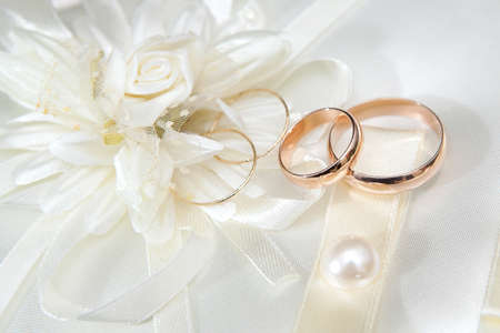 Wedding gold rings on a pillow photo