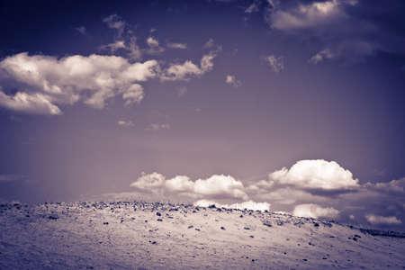 sandhills: Clouds against sandy dunes Stock Photo