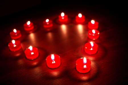 Valentines candles In the form of heart  photo