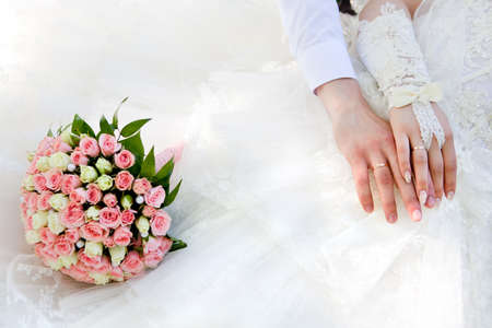 Hands of the groom and the bride with wedding rings Stock Photo - 13905639