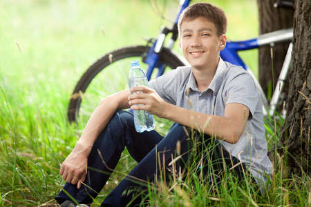 refreshes: The cyclist in the park drinking clean water  Stock Photo