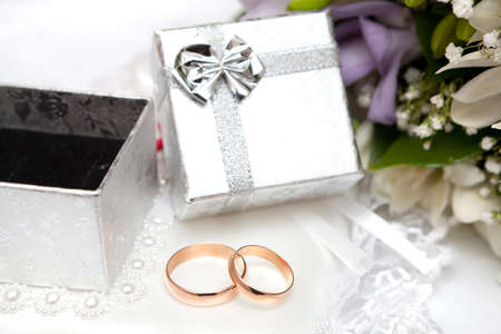 Wedding rings, gift box and flowers for the bride. Stock Photo - 15707171