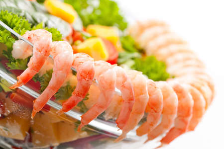 Boiled shrimp salad with cheese and vegetables. photo