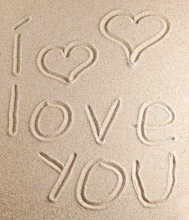 Inscription on clean sand photo