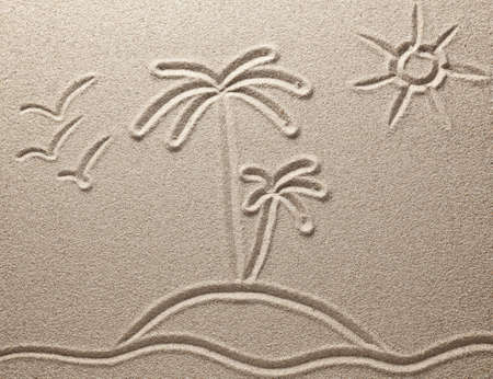 The island with palm trees in the sea is drawn on sand photo