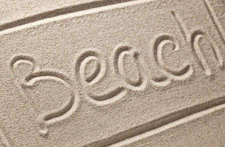 Inscription on clean sand Stock Photo - 17868274