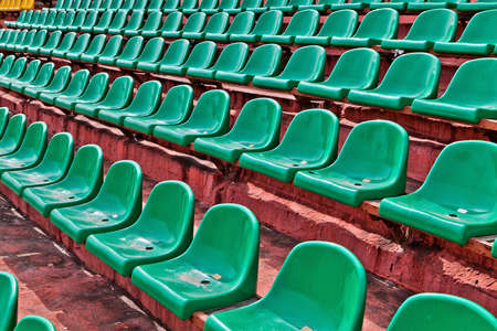 tribune: green plastic chairs on a football tribune  Stock Photo