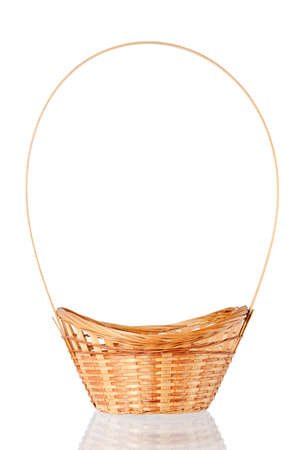 Wattled basket with reflection on a white background photo